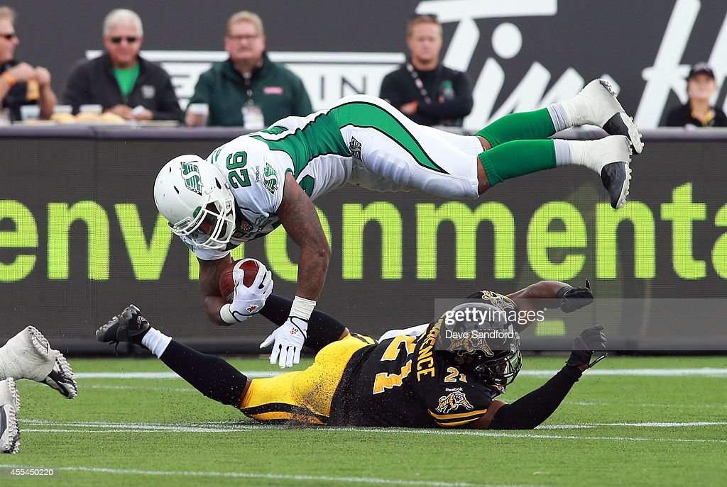 <a gi-track='captionPersonalityLinkClicked' href=/galleries/search?phrase=Anthony+Allen&family=editorial&specificpeople=542876 ng-click='$event.stopPropagation()'>Anthony Allen</a> #26 of the Saskatchewan Roughriders is tackled by Simoni Lawrence #21 of the Hamilton Tiger-Cats during their game at Tim Hortons Field on September 14, 2014 in Hamilton, Ontario, Canada.