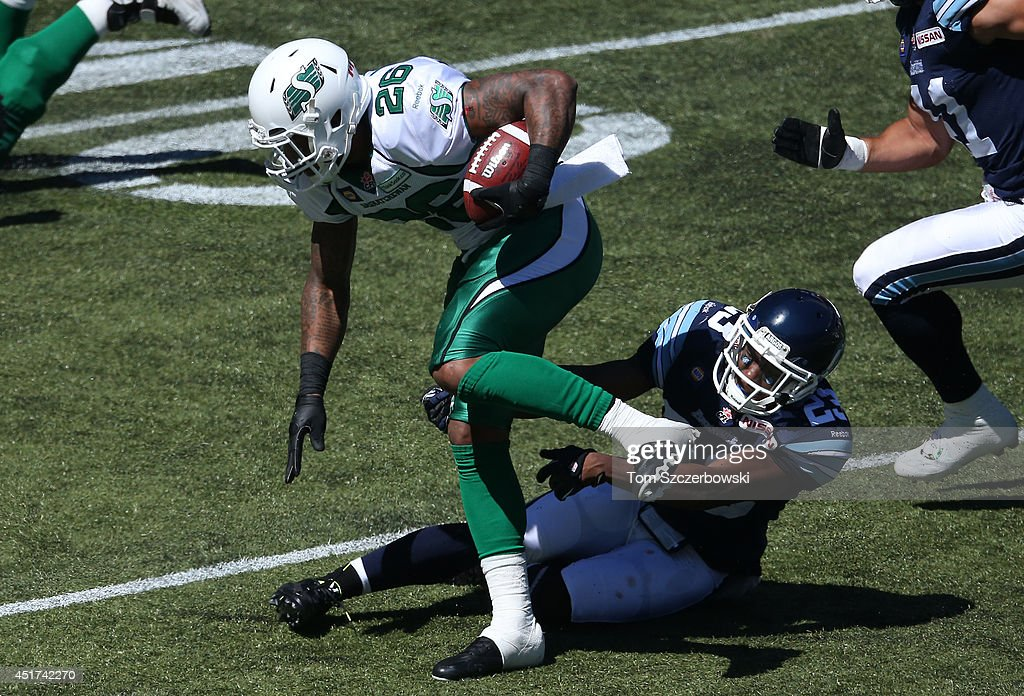 <a gi-track='captionPersonalityLinkClicked' href=/galleries/search?phrase=Anthony+Allen&family=editorial&specificpeople=542876 ng-click='$event.stopPropagation()'>Anthony Allen</a> #26 of the Saskatchewan Roughriders runs with the ball as Vincent Agnew #23 of the Toronto Argonauts attempts to bring him down during a CFL game on July 5, 2014 at Rogers Centre in Toronto, Ontario, Canada.