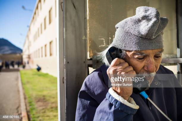 Anthony Alvarez age 82 talks on the phone to his 80yearold sister at California Men's Colony prison on December 20 2013 in San Luis Obispo California...