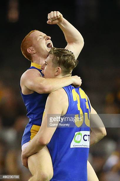 Anthony Anastasio and Tim Currie of the Seagulls celebrate winning the VFL Grand Final match between Williamstown and Box Hill at Etihad Stadium on...
