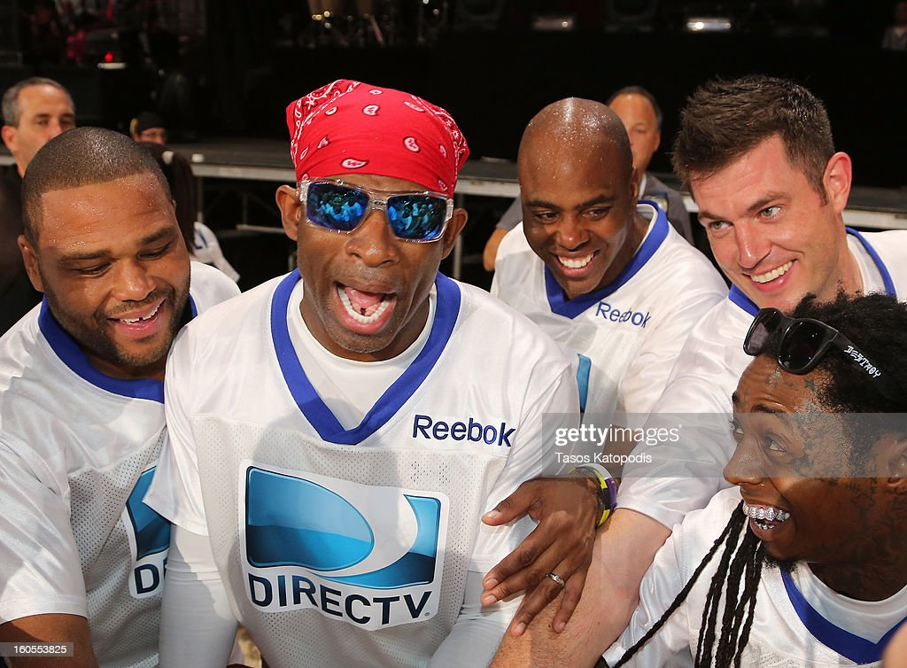 Anthony Anderson , Deion Sanders, Kevin Frazier, Jesse Palmer, and Lil Wayne attend DIRECTV'S Seventh Annual Celebrity Beach Bowl at DTV SuperFan Stadium at Mardi Gras World on February 2, 2013 in New Orleans, Louisiana.