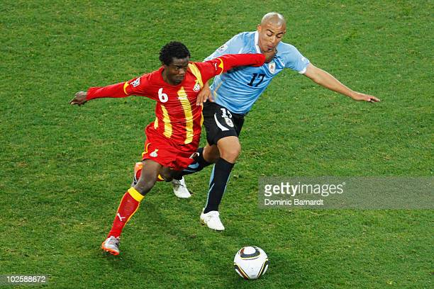 Anthony Annan of Ghana and Egidio Arevalo of Uruguay battle for the ball during the 2010 FIFA World Cup South Africa Quarter Final match between...