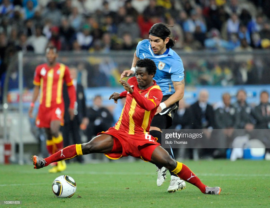 <a gi-track='captionPersonalityLinkClicked' href=/galleries/search?phrase=Anthony+Annan&family=editorial&specificpeople=646720 ng-click='$event.stopPropagation()'>Anthony Annan</a> of Ghana is challenged by <a gi-track='captionPersonalityLinkClicked' href=/galleries/search?phrase=Sebastian+Abreu&family=editorial&specificpeople=675747 ng-click='$event.stopPropagation()'>Sebastian Abreu</a> of Uruguay during the 2010 FIFA World Cup South Africa Quarter Final match between Uruguay and Ghana at the Soccer City stadium on July 2, 2010 in Johannesburg, South Africa. The match ended 1-1 after extra-time. Uruguay won 4-2 on penalties.