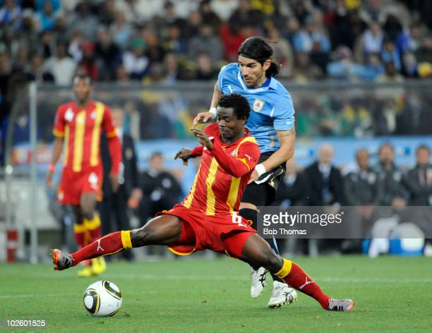 Anthony Annan of Ghana is challenged by Sebastian Abreu of Uruguay during the 2010 FIFA World Cup South Africa Quarter Final match between Uruguay...