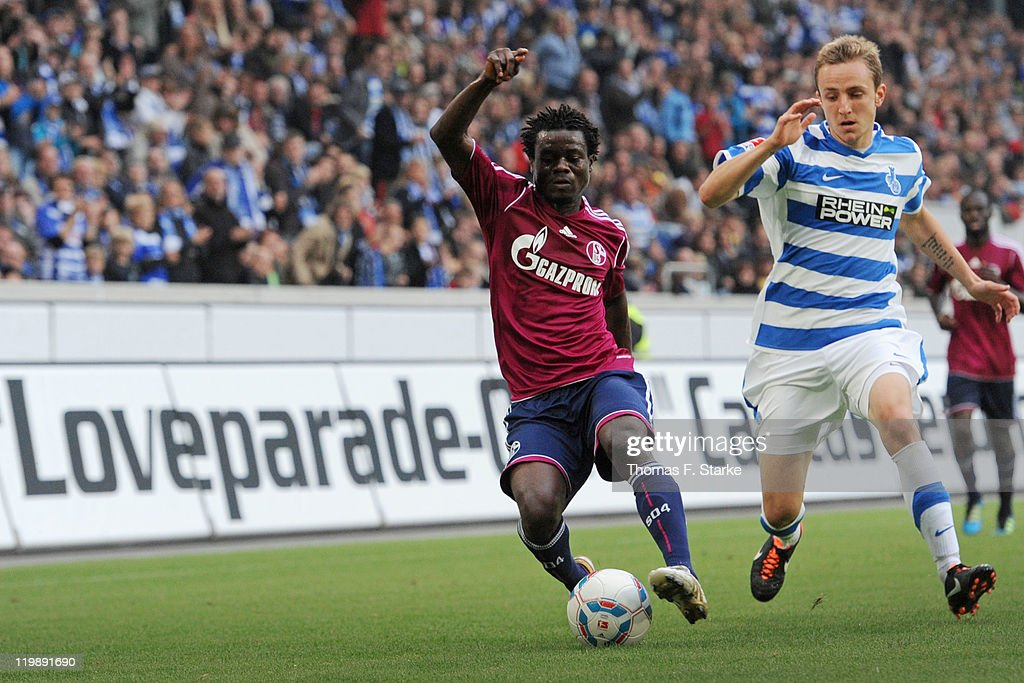 Anthony Annan (L) of Schalke and Daniel Beichler of Duisburg fight for the ball during the Loveparade charity match between MSV Duisburg and FC Schalke 04 at the Schauinsland-Reisen Arena on July 26, 2011 in Duisburg, Germany.