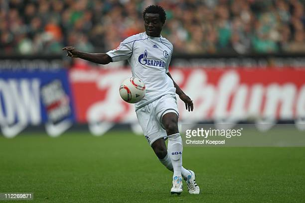 Anthony Annan of Schalke runs with the ball during the Bundesliga match between SV Werder Bremen and FC Schalke 04 at Weser Stadium on April 16 2011...