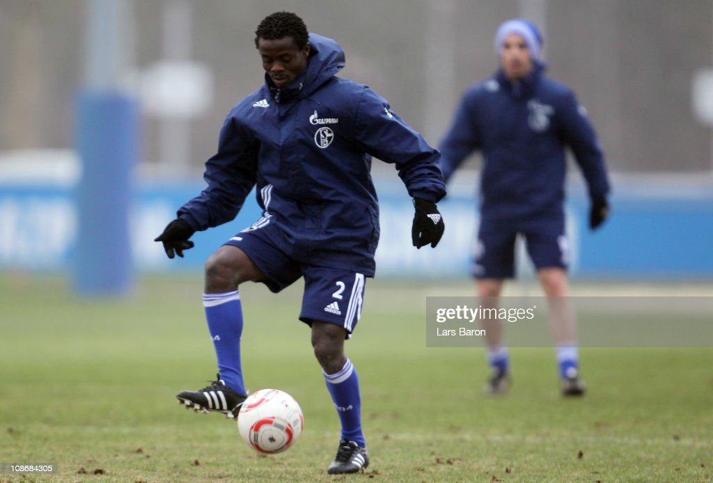 <a gi-track='captionPersonalityLinkClicked' href=/galleries/search?phrase=Anthony+Annan&family=editorial&specificpeople=646720 ng-click='$event.stopPropagation()'>Anthony Annan</a> runs with the ball during a FC Schalke 04 training session at Schalke 04 training ground on February 1, 2011 in Gelsenkirchen, Germany.