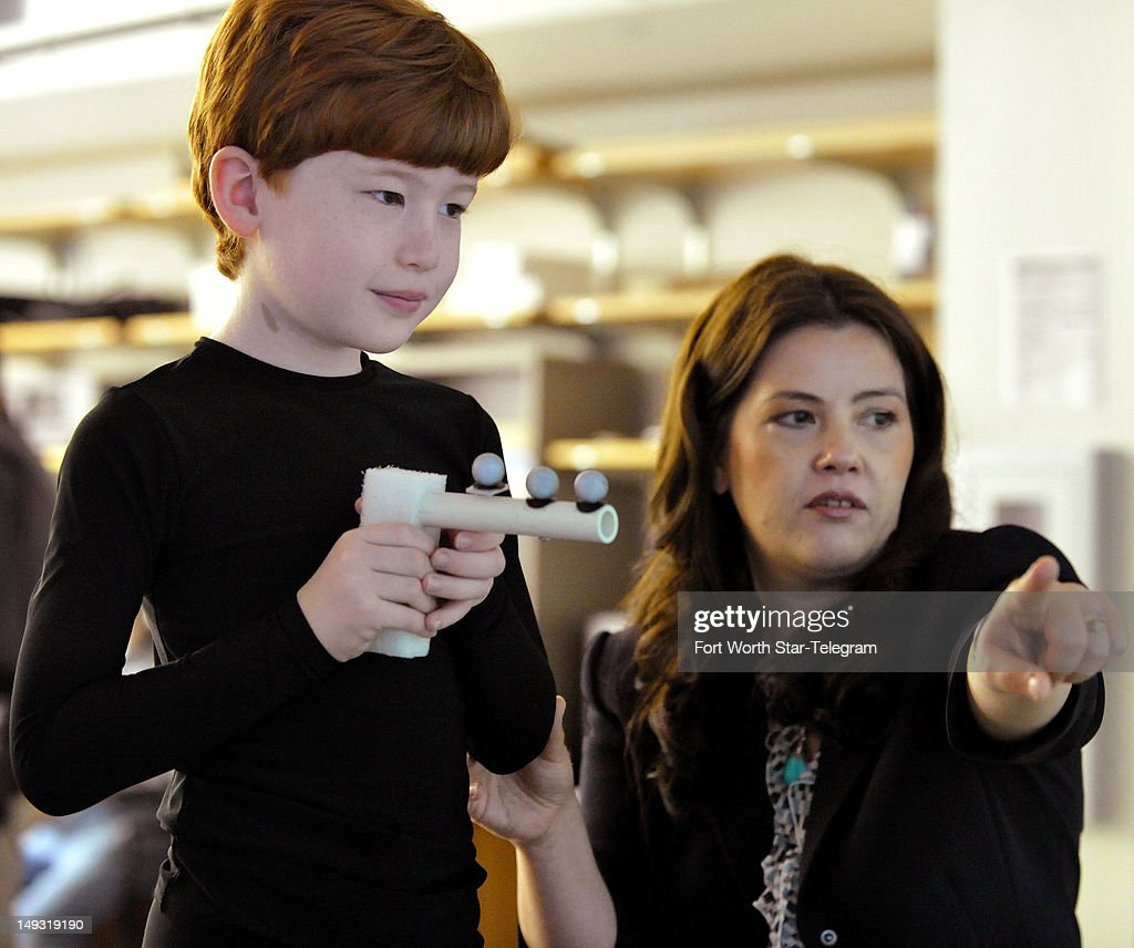 Anthony Arceri, 7, works with Nicoleta Bugnariu, right, associate professor at the University at North Texas Health Science Center and a physical therapist/neuroscientist, during his autism testing at UNT Center for Biohealth in Fort Worth, Texas, July 13, 2012.