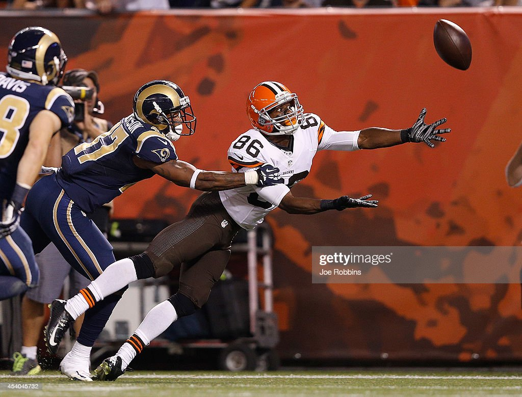 Anthony Armstrong #86 of the Cleveland Browns can't make a catch in front of Marcus Roberson #47 of the St. Louis Rams during the third quarter at FirstEnergy Stadium on August 23, 2014 in Cleveland, Ohio.