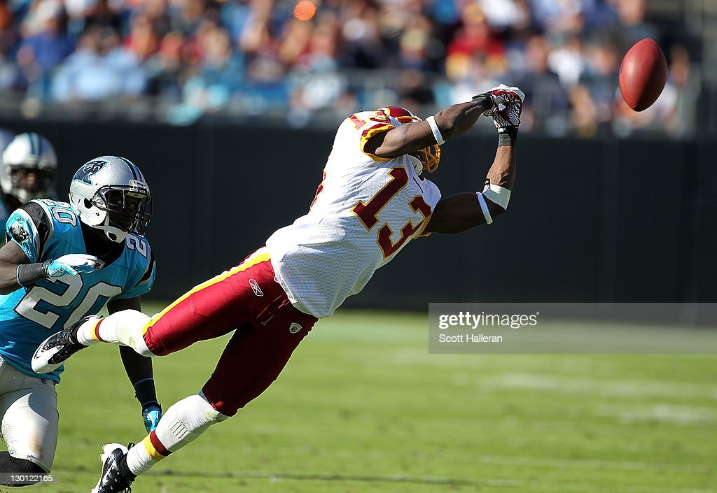 Anthony Armstrong #13 of the Washington Redskins reaches for a pass as <a gi-track='captionPersonalityLinkClicked' href=/galleries/search?phrase=Chris+Gamble&family=editorial&specificpeople=216338 ng-click='$event.stopPropagation()'>Chris Gamble</a> #20 of the Carolina Panthers looks on during their game at Bank of America Stadium on October 23, 2011 in Charlotte, North Carolina.