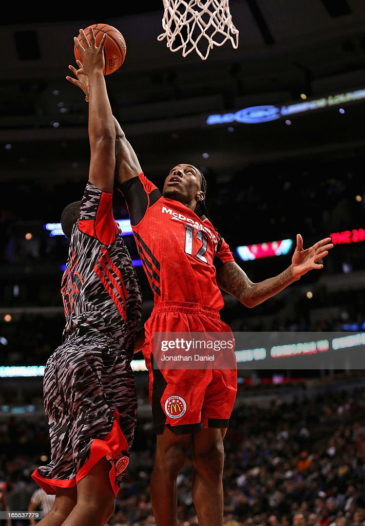 Anthony Barber #12 of the East battles for a rebound with Jarell Martin #35 of the West during the 2013 McDonald's All American game at United Center on April 3, 2013 in Chicago, Illinois. The West defeated the East 110-99.