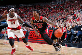 Anthony Barber of the North Carolina State Wolfpack drives to the basket against Montrezl Harrell of the Louisville Cardinals during the game at KFC...