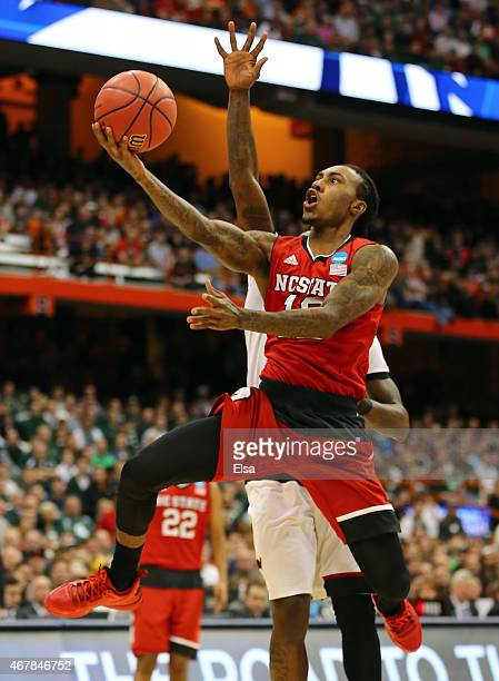 Anthony Barber of the North Carolina State Wolfpack shoots the ball against the Louisville Cardinals in the second half of the game during the East...