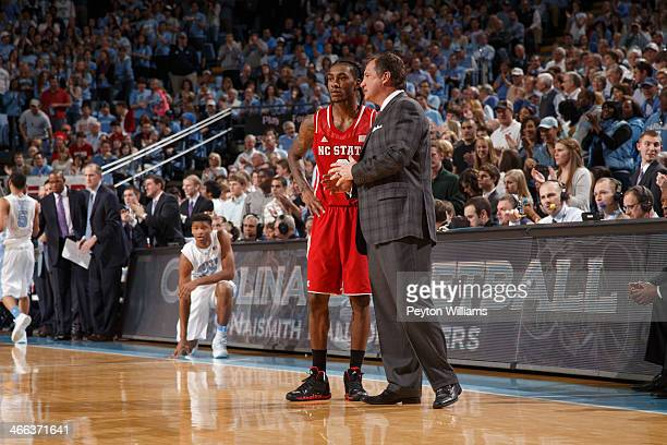 Anthony Barber of the North Carolina State Wolfpack speaks to head coach Mark Gottfried on February 01 2014 at the Dean E Smith Center in Chapel Hill...