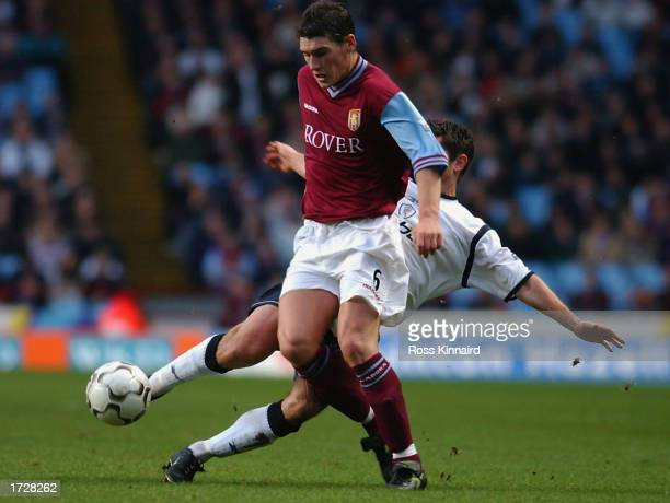 Anthony Barness of Bolton Wanderers tackles Gareth Barry of Aston Villa during the FA Barclaycard Premiership match between Aston Villa and Bolton...