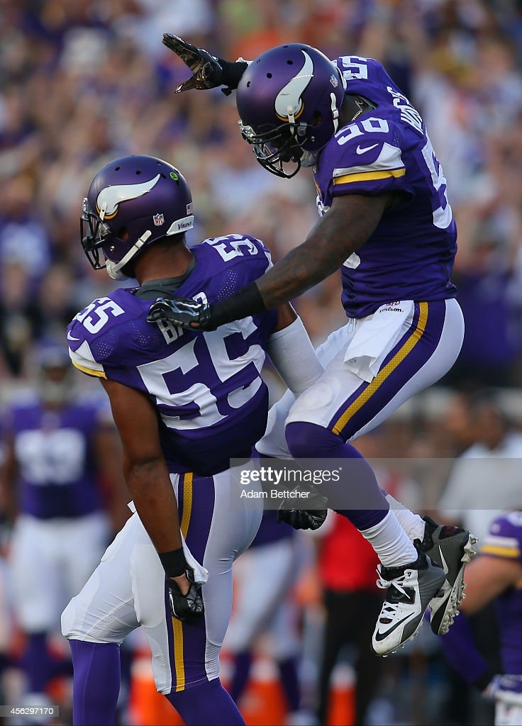 <a gi-track='captionPersonalityLinkClicked' href=/galleries/search?phrase=Anthony+Barr&family=editorial&specificpeople=7173063 ng-click='$event.stopPropagation()'>Anthony Barr</a> #55 of the Minnesota Vikings celebrates his sack of Matt Ryan of the Atlanta Falcons with <a gi-track='captionPersonalityLinkClicked' href=/galleries/search?phrase=Michael+Mauti&family=editorial&specificpeople=5630085 ng-click='$event.stopPropagation()'>Michael Mauti</a> #56 at TCF Bank Stadium on September 28, 2014 in Minneapolis, Minnesota.