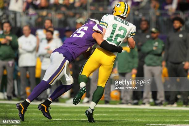 Anthony Barr of the Minnesota Vikings hits quarterback Aaron Rodgers of the Green Bay Packers during the first quarter of the game on October 15 2017...