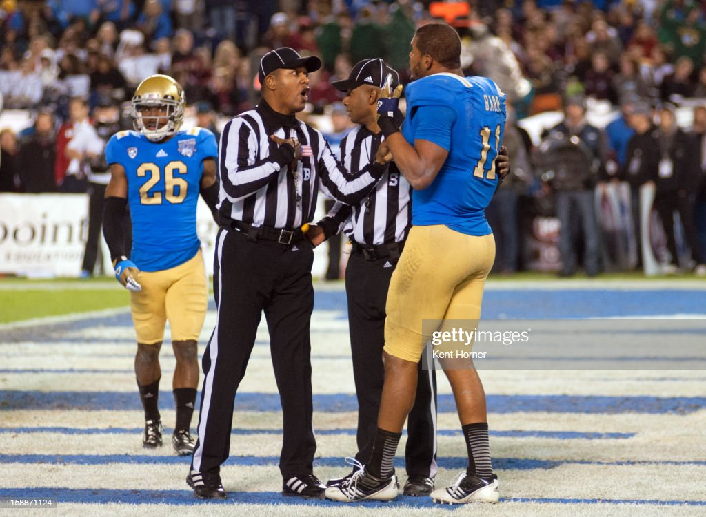 SAN DIEGO, CA - DECEMBER 27 - Anthony Barr #11 of the UCLA Bruins has words with Back Judge referee Ivan Daniels after losing his helmet during a goal line play in the first half of the game against the Baylor Bears in the Bridgepoint Education Holiday Bowl at Qualcomm Stadium on December 27, 2012 in San Diego, California.