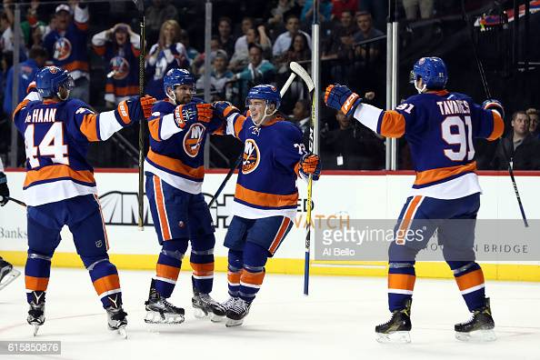 Anthony Beauvillier of the New York Islanders celebraes with teammates John Tavares Dennis Seidenberg and Calvin de Haan after scoring a goal in the...