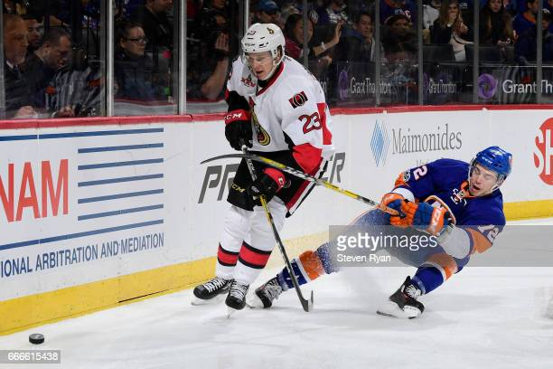 Anthony Beauvillier of the New York Islanders skates for the puck against Jyrki Jokipakka of the Ottawa Senators during the game at Barclays Center...