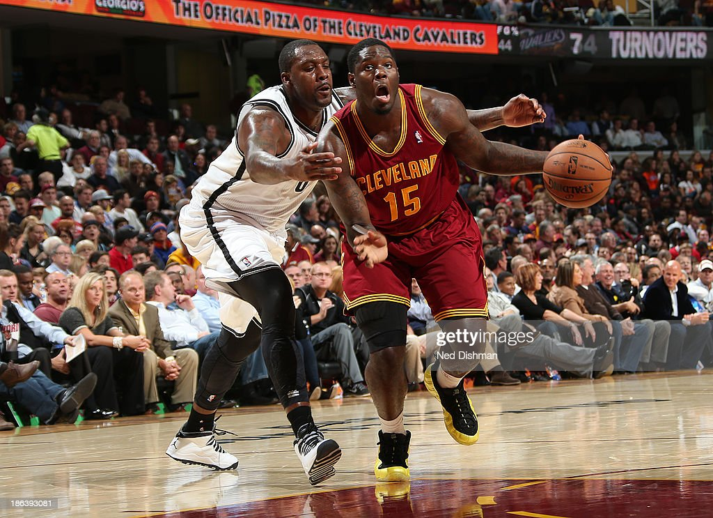 Anthony Bennett #15 of the Cleveland Cavaliers drives against <a gi-track='captionPersonalityLinkClicked' href=/galleries/search?phrase=Andray+Blatche&family=editorial&specificpeople=4282797 ng-click='$event.stopPropagation()'>Andray Blatche</a> #0 the Brooklyn Nets during a game at the Quicken Loans Arena on October 30, 2013 in Cleveland, Ohio.
