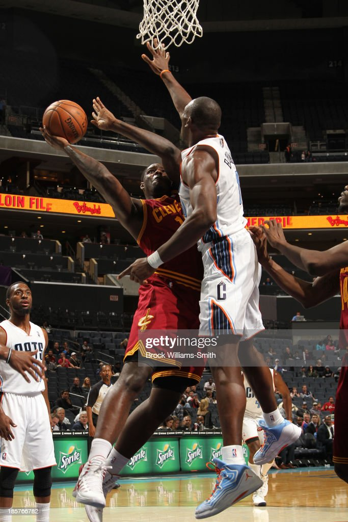 Anthony Bennett #15 of the Cleveland Cavaliers shoots against <a gi-track='captionPersonalityLinkClicked' href=/galleries/search?phrase=Bismack+Biyombo&family=editorial&specificpeople=7640443 ng-click='$event.stopPropagation()'>Bismack Biyombo</a> #0 of the Charlotte Bobcats during the game at the Time Warner Cable Arena on October 24, 2013 in Charlotte, North Carolina.