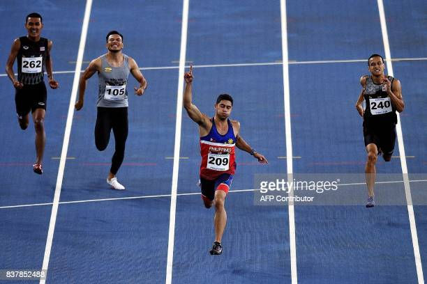 Anthony Beram of Philippines competes in the men's 200m athletics final of the 29th Southeast Asian Games at the Bukit Jalil national stadium in...