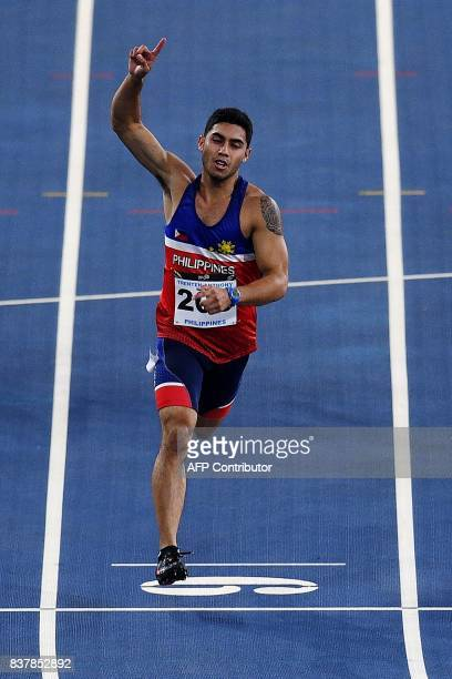 Anthony Beram of Philippines crosses the finish line first to win the men's 200m athletics final of the 29th Southeast Asian Games at the Bukit Jalil...
