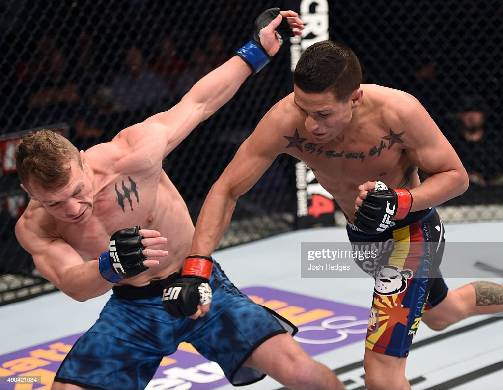 Anthony Birchak punches Ian Entwistle in their bantamweight fight during the UFC Fight Night event at the U.S. Airways Center on December 13, 2014 in Phoenix, Arizona.