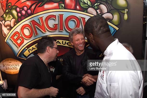 Anthony Bongiovi musician Jon Bon Jovi and Chef David Stample interact at the Bongiovi Brand chef station at Ronzoni's La Sagra Slices hosted by...