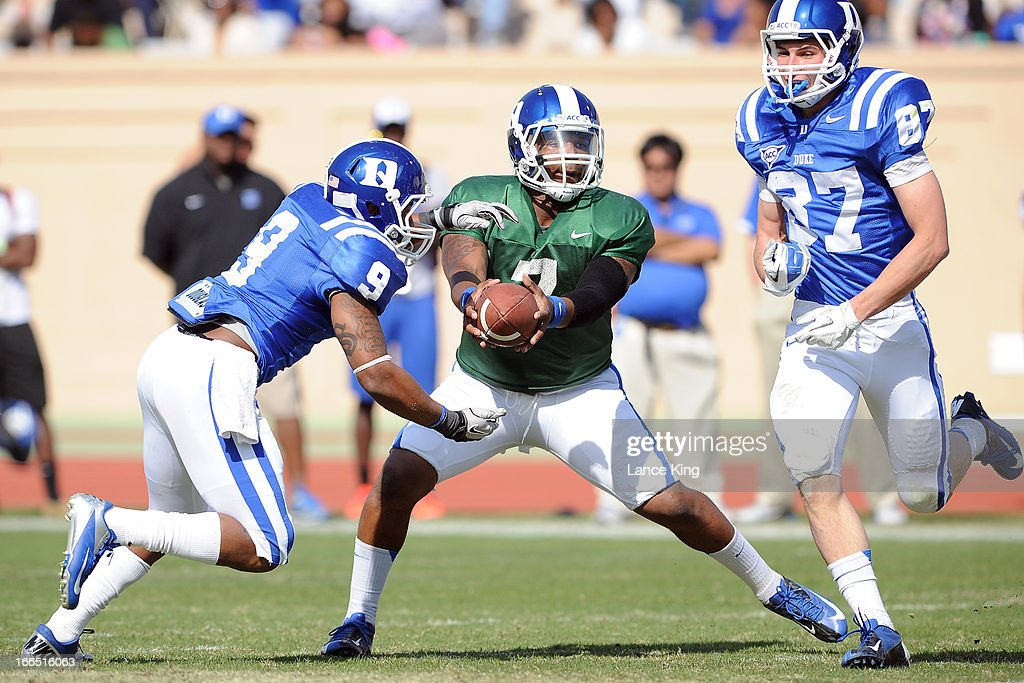 Anthony Boone #7 hands off to Josh Snead #9 of the Duke Blue Devils during their Spring Game at Wallace Wade Stadium on April 13, 2013 in Durham, North Carolina.