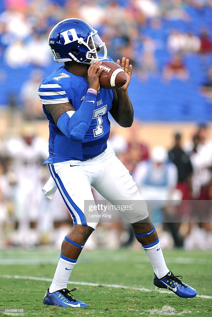 Anthony Boone #7 of the Duke Blue Devils drops back to pass against the Elon Phoenix at Wallace Wade Stadium on August 30, 2014 in Durham, North Carolina.