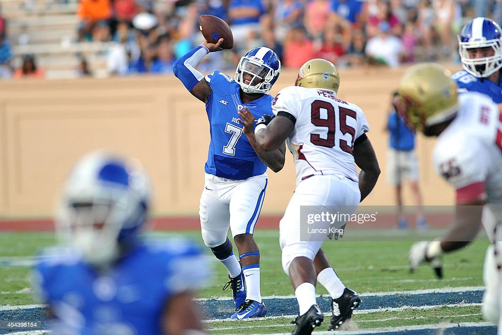Anthony Boone #7 of the Duke Blue Devils passes the ball against the Elon Phoenix at Wallace Wade Stadium on August 30, 2014 in Durham, North Carolina.