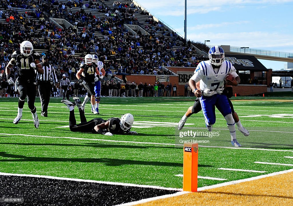 Anthony Boone #7 of the Duke Blue Devils runs a quarterback keeper against the Wake Forest Demon Deacons during play at BB&T Field on November 23, 2013 in Winston Salem, North Carolina. Duke won 28-21.