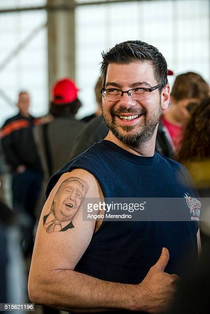 Anthony Borbell of Warren Ohio shows his tattoo of Republican Presidential Candidate Donald Trump at Youngstown Airport on March 14 2016 in Vienna...