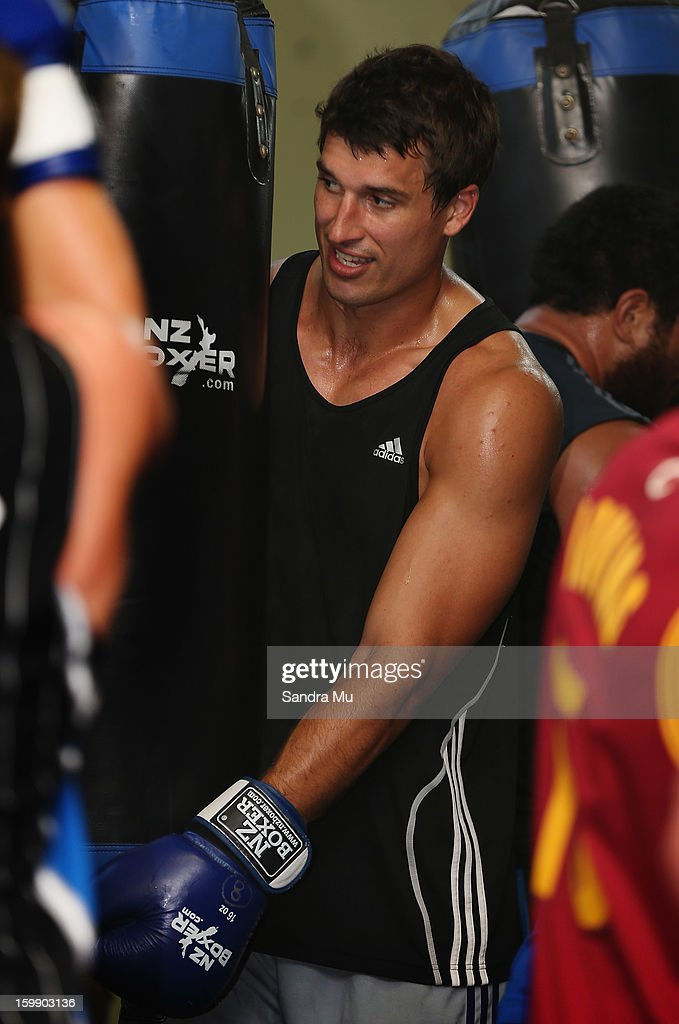 Anthony Boric holds the boxing bag during a Blues training session with Shane Cameron at Shane Cameron Fitness on January 23, 2013 in Auckland, New Zealand.