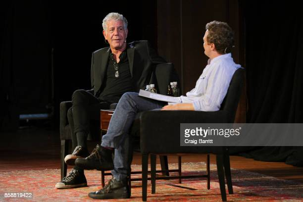 Anthony Bourdain and Patrick Radden Keefe speak onstage during the panel Anthony Bourdain talks with Patrick Radden Keefe at New York Society for...