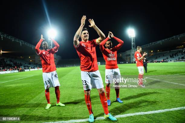 Anthony Briancon and Christian Kouakou and Gael Angoula of Nimes celebrates the Victory during the Ligue 2 match between Nimes Olympique and Red Star...