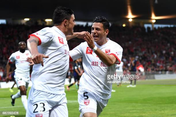 Anthony Briancon of Nimes celebrates his goal with Larry Azouni of Nimes during the Ligue 2 match between Nimes Olympique and AC Ajaccio on May 12...