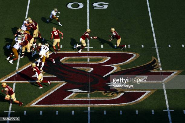 Anthony Brown of the Boston College Eagles hands the ball off to Jon Hilliman during the first half against the Notre Dame Fighting Irish at Alumni...