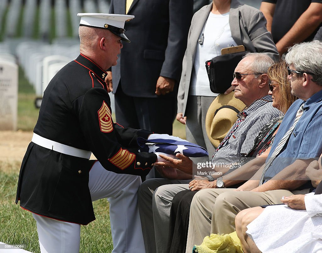 Anthony Brozyna recieves an American flag that covered the casket of his uncle US Marine PFC Anthony Brozyna of Hartford CT during a full honors...