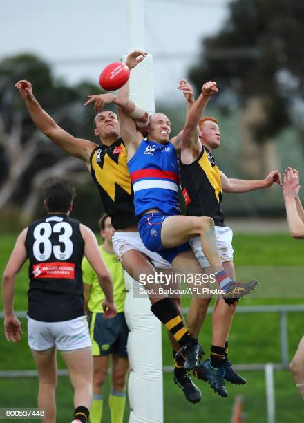 Anthony Bruhn of Footscray Braydon Preuss of Werribee and Ryley Barrack of Werribee compete for the ball during the 2017 VFL round 10 match between...