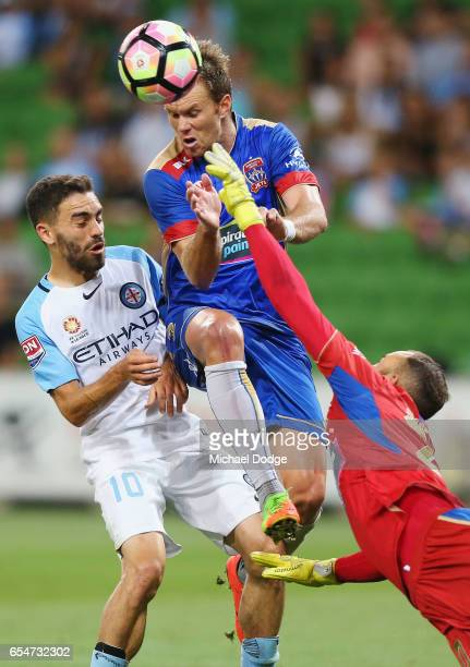 Anthony Caceras the City and Alexsandr Kokko of the Jets compete for the ball with Jets Keeper Jack Duncan during the round 23 ALeague match between...