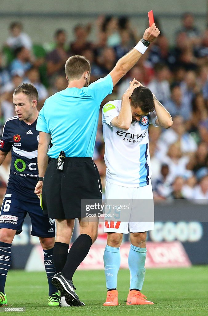 Anthony Caceres of City Fc is given a red card by referee Chris Beath during the round 19 A-League match between Melbourne City FC and Melbourne Victory at AAMI Park on February 13, 2016 in Melbourne, Australia.