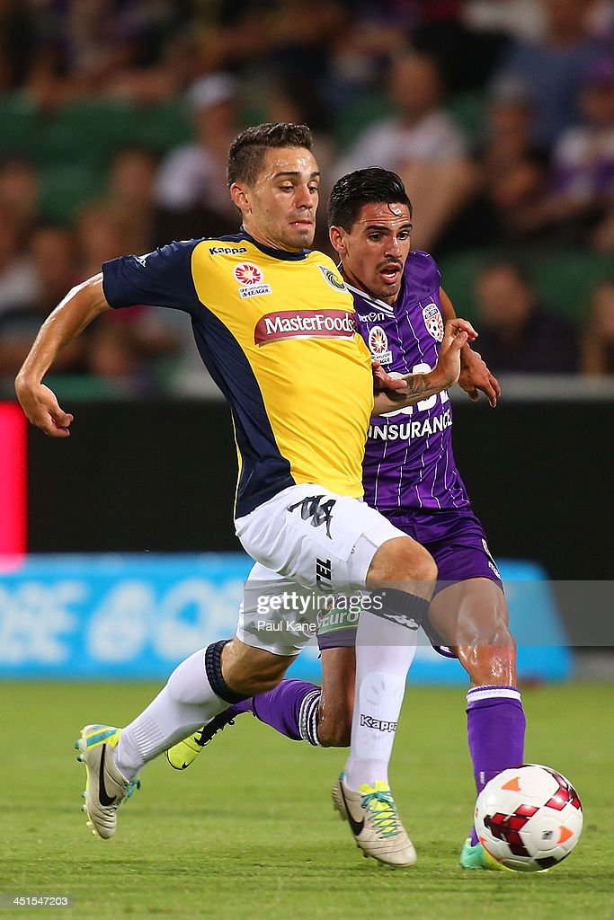 Anthony Caceres of the Mariners controls the ball against Ryan Edwards of the Glory during the round seven A-League match between Perth Glory and the Central Coast Mariners at nib Stadium on November 23, 2013 in Perth, Australia.