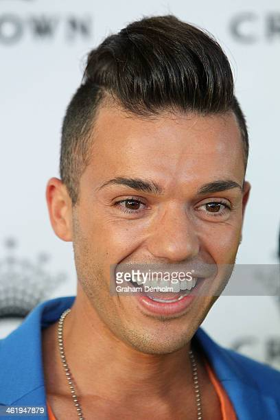 Anthony Callea smiles as he arrives at the IMG tennis players party at Crown Towers on January 12 2014 in Melbourne Australia
