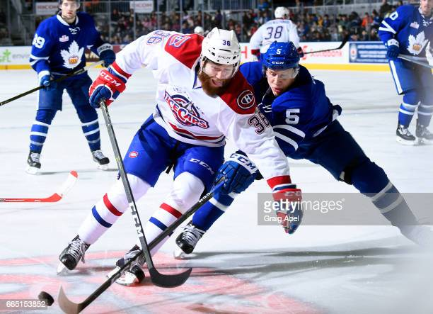 Anthony Camara of the St John's IceCaps battles for the puck with Steven Oleksy of the Toronto Marlies during AHL game action on April 4 2017 at...