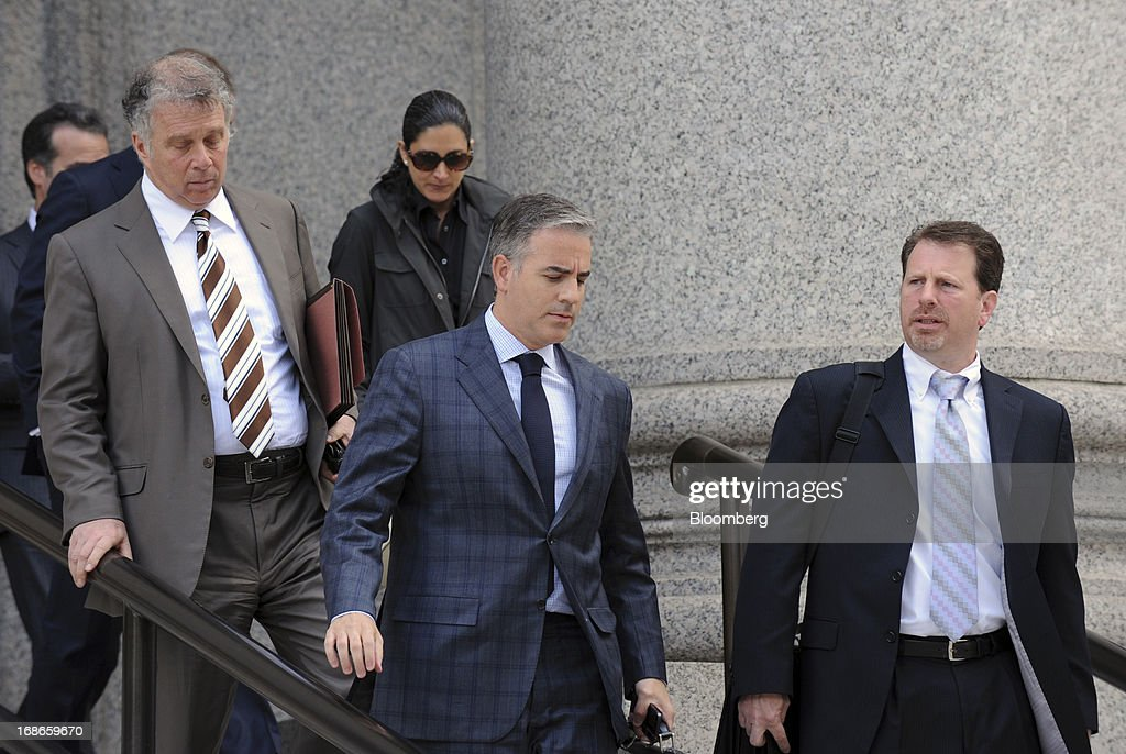 Anthony Chiasson, co-founder of Level Global Investors LP, center, exits federal court with his attorneys Reid Weingarten, left, and Gregory Morvillo, right, following a sentencing hearing in New York, U.S., on Monday, May 13, 2013. Chiasson was sentenced to 6 1/2 years in prison for using illegal tips funneled to him from analysts and company insiders to make $68 million for his hedge fund. Photographer: Peter Foley/Bloomberg via Getty Images