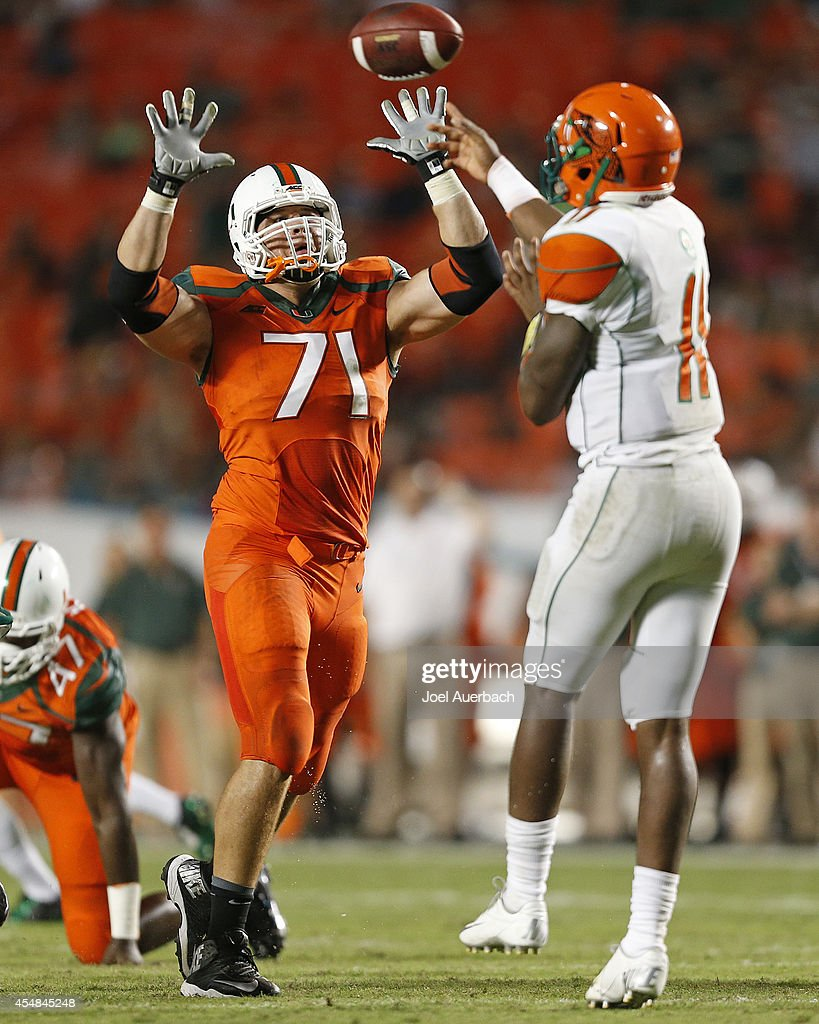 <a gi-track='captionPersonalityLinkClicked' href=/galleries/search?phrase=Anthony+Chickillo&family=editorial&specificpeople=8099807 ng-click='$event.stopPropagation()'>Anthony Chickillo</a> #71 of the Miami Hurricanes attempts to block the pass by Damien Fleming #11 of the Florida A&M Rattlers on September 6, 2014 at Sun Life Stadium in Miami Gardens, Florida. The Hurricanes defeated the Rattlers 41-7.