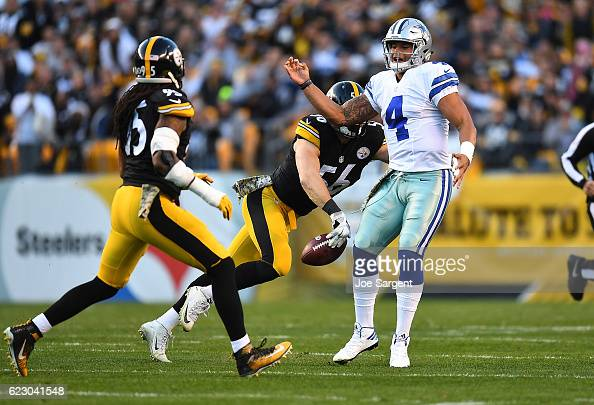 Anthony Chickillo of the Pittsburgh Steelers strips the ball away from Dak Prescott of the Dallas Cowboys for a fumble in the first quarter during...